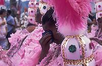Samba schools parade, end of party -  baiana, elderly black woman wearing pink costumes from Mangueira Samba School cries at the end of the parade at dawn - emotion - Rio de Janeiro carnival, Brazil.