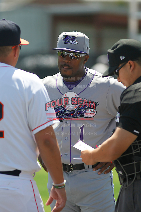 Winston-Salem Dash manager Willie Harris (1) meeting with the umpires before a game against the Buies Creek Astros at Jim Perry Stadium on the campus of Campbell University on April 9, 2017 in Buies Creek, North Carolina. Buies Creek defeated Winston-Salem 2-0. (Robert Gurganus/Four Seam Images)