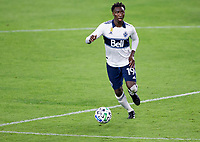 LOS ANGELES, CA - SEPTEMBER 23: Janio Bikel #19 of the Vancouver Whitecaps looks for an open man during a game between Vancouver Whitecaps and Los Angeles FC at Banc of California Stadium on September 23, 2020 in Los Angeles, California.