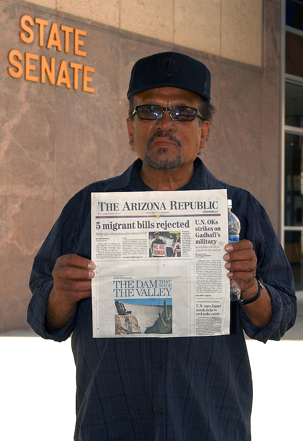 """AJ Alexander - Tomas Alejo (cq) 64 from California holds todays paper with the """"5 migrant bills rejected"""" headline at the Arizona State Capitol on Friday March 18, 2011..Photo by AJ Alexander .All Rights Reserved"""
