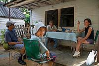Senior tobacco farmer receiving guests at his home in Vinales, Pinar del Rio Province, Cuba.