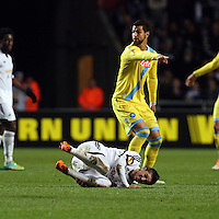 Swansea, UK. Thursday 20 February 2014<br /> Pictured: Pablo Hernandez of Swansea is fouled by Miguel Britos of Napoli<br /> Re: UEFA Europa League, Swansea City FC v SSC Napoli at the Liberty Stadium, south Wales, UK