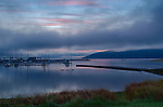 Idaho, North, Sandpoint. Clouds glow a soft pink in the pre-dawn light over the Sandpoint marina.
