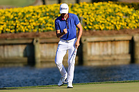 14th March 2021; Ponte Vedra Beach, Florida, USA;  Justin Thomas of the United States reacts after sinking a putt on the 17th hole during the final round of THE PLAYERS Championship on March 14, 2021 at TPC Sawgrass Stadium Course in Ponte Vedra Beach, Fl.