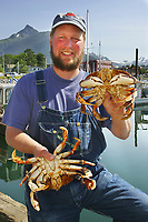 Commercial fisherman, Louis Holst, sells dungeouness crabs at the Thomsen harbor in Sitka, Alaska