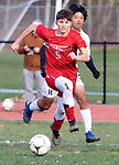 WINSTED CT. - 17 November 2020-111720SV05-#5 Jacob Brodnitzki of Northwestern and #4 Carlos Lopez-Gonzalez Housatonic chase down the ball during Berkshire League boy's soccer tournament action in Winsted Tuesday.<br /> Steven Valenti Republican-American