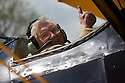 """30/05/16<br /> <br /> Practicing for a 100 mph low-level air display to mark the Queen's 90th birthday Cliff Crozier sits in a vintage biplane, waving enthusiastically as smoke fills the cockpit.<br /> <br /> Surely this must make Cliff, who turned one hundred last year, one of the most spritely centenarians in Britain?<br /> <br /> Full story here: http://www.fstoppress.com/articles/2016/05/30/cliff_crozier_boeing_stearman/<br /> <br /> .Cliff's nieces bought him a flight in a Tiger Moth, similar to the one he first flew in in 1942, and yesterday he took to the skies above Derbyshire taking the controls for 15 minutes.<br /> <br /> After landing at Darley Moor Airfield near Ashbourne, Cliff hopped out of the Tiger Moth and beaming from ear to ear, said: """"It brought back more than a few memories - it was very exciting - not like flying in a modern aircraft"""".<br /> <br /> Will Flanagan, Chief Flying Instructor at Blue Eye Aviation said: """"He's the oldest passenger we've ever had. Many elderly people need to be lifted in and out of the cockpit but Cliff climbed in and out, almost without any help at all. You'd never believe he's a hundred""""<br /> <br /> All Rights Reserved, F Stop Press Ltd. +44 (0)1335 418365"""