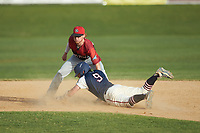 Deep River Muddogs shortstop Alec Bell (10) (Pfeiffer University) applies a late tag as Jeremy Simpson (9) (Catawba) of the High Point-Thomasville HiToms slides into second base at Finch Field on June 27, 2020 in Thomasville, NC.  The HiToms defeated the Muddogs 11-2. (Brian Westerholt/Four Seam Images)