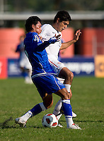 Alejandro Guido (10) of the United States keeps the ball away from Brayan Landaverde (6) of El Salvador during the quarterfinals of the CONCACAF Men's Under 17 Championship at Catherine Hall Stadium in Montego Bay, Jamaica. The USA defeated El Salvador, 3-2, in overtime.