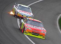 Feb 22, 2009; Fontana, CA, USA; NASCAR Sprint Cup Series driver Jeff Gordon leads Greg Biffle during the Auto Club 500 at Auto Club Speedway. Mandatory Credit: Mark J. Rebilas-