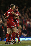 George North and Dan Biggar celebrate with Rhys Webb after the scrum half scores a try for Wales.<br /> Dove men Series 2014<br /> Wales v New Zealand<br /> 22.11.14<br /> ©Steve Pope -SPORTINGWALES