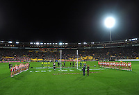The teams line up before kickoff during the Australian Rules Football ANZAC Day match between St Kilda Saints and Sydney Swans at Westpac Stadium, Wellington, New Zealand on Thursday, 24 May 2013. Photo: Dave Lintott / lintottphoto.co.nz