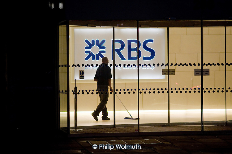 Cleaner on a a night shift at Royal Bank of Scotland offices in the City of London