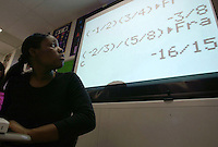 High school student Latanya McWhite ponders data on an Algerbra question in her class at  the Harrisburg University of Science and Technology program Friday, Oct 17, 2003 in Harrisburg, PA. (AP Photo/Brad C Bower)