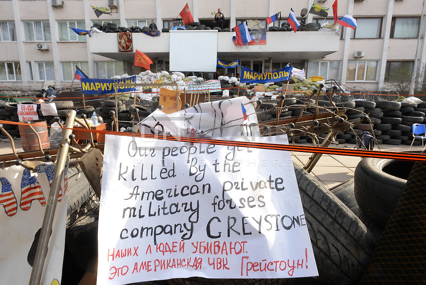 Barricades bulit by Pro-russian activists in front of the Mariupol military base