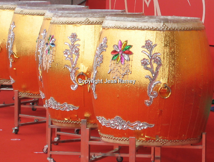 Gold drums are played at a Chinese ceremony