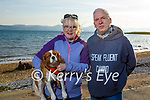 Enjoying a stroll in Fenit on Thursday, l to r: Deirdre and Martin Moore with Jazz the dog.