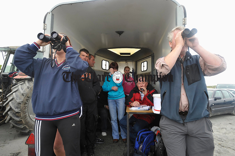 Anne Potter and Dixie Collins keep wqwtch for the boats as Eugene Costello, centre, makes the commentary during the Leon Currach Regatta at Seafield, Quilty. Photograph by John Kelly.