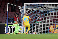 Thursday 27 February 2014<br /> Pictured: Gokhan Inler of Napoli (R) scores against Michel Vorm of Swansea (R) to seal the win with a 3-0<br /> Re: UEFA Europa League, SSC Napoli v Swansea City FC at Stadio San Paolo, Naples, Italy.