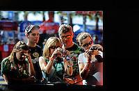 Feb 07, 2009; Daytona Beach, FL, USA; Fans of NASCAR Sprint Cup Series driver Dale Earnhardt Jr (not pictured) look into his garage stall during practice for the Daytona 500 at Daytona International Speedway. Mandatory Credit: Mark J. Rebilas-