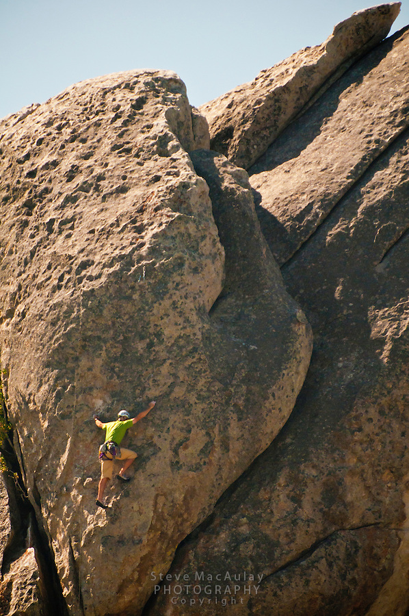 "Rock climber on ""Rock Lobster"" City of Rocks National Reserve, Idaho."
