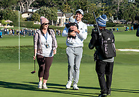 9th February 2020, Pebble Beach, Carmel, California, USA; Nick Taylor and his family celebrate on the 18th green after winning the championship round of the AT&T Pro-Am on Sunday