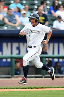 NW Arkansas Naturals outfielder Lane Adams (6) scores a run during a game against the Corpus Christi Hooks on May 26, 2014 at Arvest Ballpark in Springdale, Arkansas.  NW Arkansas defeated Corpus Christi 5-3.  (Mike Janes/Four Seam Images)