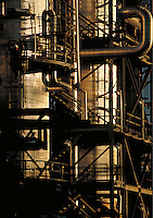 worker on refinery stacks