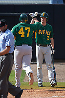Siena Saints Brett Connors (2) congratulates Joe Drpich (47) after a home run during a game against the UCF Knights on February 21, 2016 at Jay Bergman Field in Orlando, Florida.  UCF defeated Siena 11-2.  (Mike Janes/Four Seam Images)