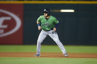 Adam Duvall (14) of the Gwinnett Braves takes his lead off of second base against the Charlotte Knights at BB&T BallPark on July 12, 2019 in Charlotte, North Carolina. The Stripers defeated the Knights 9-3. (Brian Westerholt/Four Seam Images)