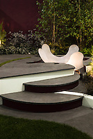 Circular tiered Patio & steps, garden modern outdoor landscape lighting, wall, modern plantings, bamboo, lights for evening enjoyment at night