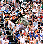 The ESPN X-Games is the premier action sports competition featuring: aggressive in-line skating, bicycle stunt, motox,skateboarding, speed climbing, street luge & wakeboarding..  Bike Stunt rider Ryan Nyquist is head over heels off one of the ramps in front of a hugh crowd during the Bike Stunt Park competition of the 2001 X-Games held at the First Union Center, Philadelpia PA. (MARK R. SULLIVAN)