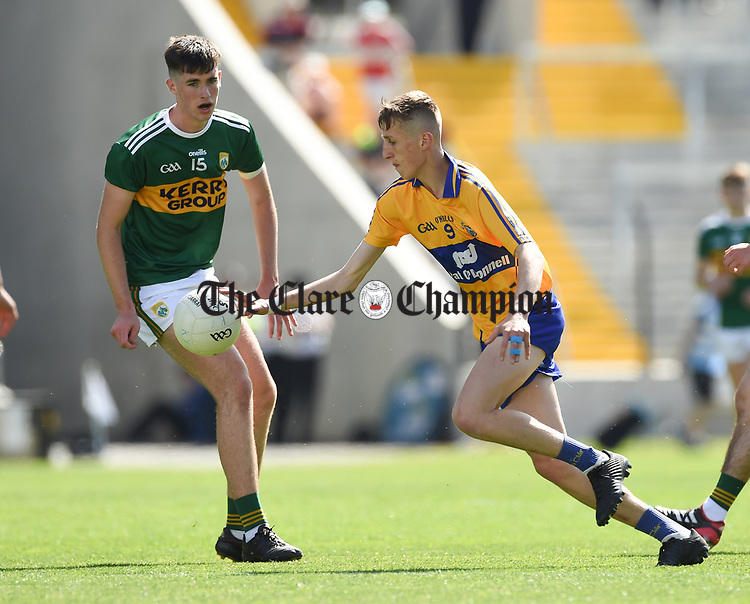 Darragh Lyne of Kerry in action against Mark McInerney of Clare during their Munster Minor football final at Pairc Ui Chaoimh. Photograph by John Kelly.