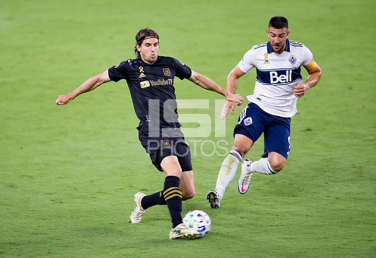 LOS ANGELES, CA - SEPTEMBER 23: Dejan Jakovic #5of LAFC crosses a ball during a game between Vancouver Whitecaps and Los Angeles FC at Banc of California Stadium on September 23, 2020 in Los Angeles, California.
