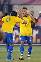 Neymar (11) of Brazil celebrates scoring with Andre Santos (6). The men's national team of Brazil (BRA) defeated the United States (USA) 2-0 during an international friendly at the New Meadowlands Stadium in East Rutherford, NJ, on August 10, 2010.