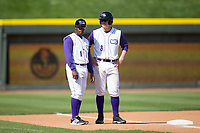 Winston-Salem Dash manager Willie Harris (1) talks to Zack Collins (8) as he stands on third base during the game against the Buies Creek Astros at BB&T Ballpark on April 16, 2017 in Winston-Salem, North Carolina.  The Dash defeated the Astros 6-2.  (Brian Westerholt/Four Seam Images)