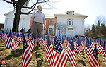 SEYMOUR, CT. 02 April 2009-040209SV08--Rev. Greg Dawson of the Seymour Congregational Church walks through the Field of Flags Memorial, which is a traveling memorial that honors those service men and women who died in Iraq and Afghanistan. There are 4929 flags in the memorial at the church and two will be added Sunday for two more soldiers that died in Afghanistan. Steven Valenti Republican-American