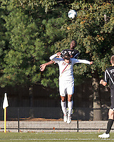 Boston College forward/midfielder Diego Medina-Mendez (15) and Brown University defender Alex Markes (3) battle for head ball. Brown University (black) defeated Boston College (white), 1-0, at Newton Campus Field, October 16, 2012.