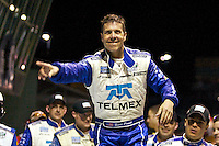 Scott Pruett celebrate after climbing from his car after winning the Grand Prix of Miami, Homestead-Miami Speedway, March 2010.  (Photo by Brian Cleary/www.bcpix.com)