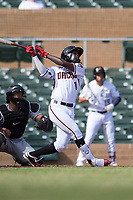 Salt River Rafters shortstop Jazz Chisholm (1), of the Arizona Diamondbacks organization, follows through on his swing in front of catcher Li-Jen Chu (2) during in front of an Arizona Fall League game against the Glendale Desert Dogs at Salt River Fields at Talking Stick on October 31, 2018 in Scottsdale, Arizona. Glendale defeated Salt River 12-6 in extra innings. (Zachary Lucy/Four Seam Images)