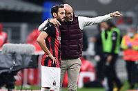Stefano Pioli of AC Milan and Hakan Calhanoglu during the Serie A football match between AC Milan and Spezia Calcio at San Siro Stadium in Milano  (Italy), October 4th, 2020. Photo Image Sport / Insidefoto