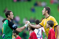 MELBOURNE, AUSTRALIA - OCTOBER 23: Clint Bolton of the Heart and Glen Moss of Gold Coast shake hands during the A-League match between the Melbourne Heart and Gold Coast United at AAMI Park on October 23, 2010 in Melbourne, Australia. (Photo by Sydney Low / Asterisk Images)