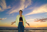 A woman enjoying sunset at Maunakea Beach
