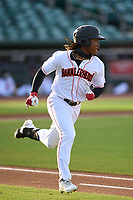 Jupiter Hammerheads Osiris Johnson (3) runs to first base during a game against the Palm Beach Cardinals on May 11, 2021 at Roger Dean Chevrolet Stadium in Jupiter, Florida.  (Mike Janes/Four Seam Images)