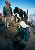 .Peshawar / Pakistan.Jalozai refugee camp run by UNHCR. In the picture some refugees fled from Afghanistan because of the war between the Taliban and the Armies of the International Coalition..Photo Livio Senigalliesi
