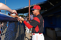 Batavia Muckdogs manager Mike Jacobs (28) signs autographs before a game against the Auburn Doubledays on July 4, 2017 at Dwyer Stadium in Batavia, New York.  Batavia defeated Auburn 3-2.  (Mike Janes/Four Seam Images)