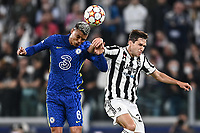 29th September 2021; Turin, Italy;  Thiago Silva challenges Federico Chiesa UEFA Champions League;  group H match between Juventus and Chelsea at the Juventus Stadium, Turin, Italy