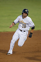 San Antonio Missions third baseman Jake Blackwood (10) runs to third base during the Texas League baseball game against the Midland RockHounds on July 13, 2013 at Nelson Wolff Municipal Stadium in San Antonio, Texas. The Missions defeated the Rock Hounds 5-4. (Andrew Woolley/Four Seam Images)