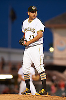 Bradenton Marauders relief pitcher Luis Heredia (37) gets ready to deliver a pitch during a game against the Fort Myers Miracle on April 9, 2016 at McKechnie Field in Bradenton, Florida.  Fort Myers defeated Bradenton 5-1.  (Mike Janes/Four Seam Images)