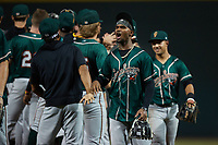 Liover Peguero (10) of the Greensboro Grasshoppers celebrates with his teammates following their win over the Winston-Salem Dash at Truist Stadium on August 13, 2021 in Winston-Salem, North Carolina. (Brian Westerholt/Four Seam Images)